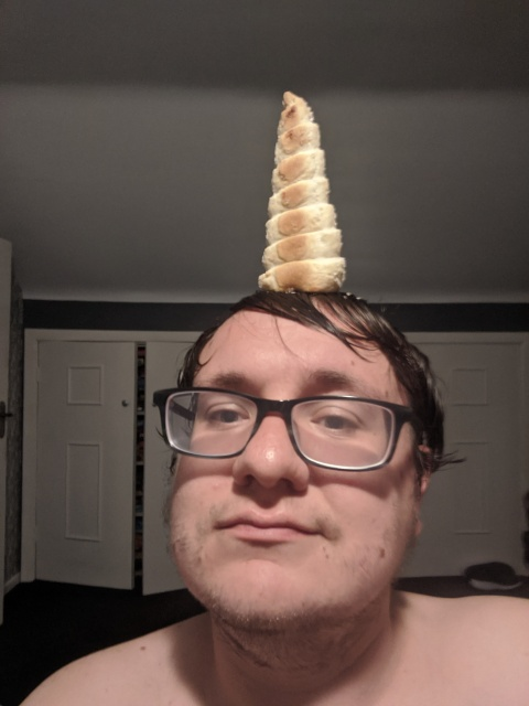 Selfie with a cream horn balanced on my head